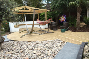 Granite patio, raised beds and water feature Ampfield